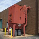 Service and cleaning of a commercial dust collector